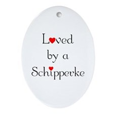 Loved by a Schipperke Oval Ornament