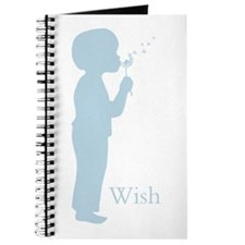 Boy blowing a dandelion to make a wish Journal