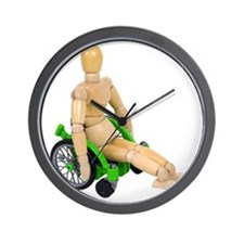 Riding a wheelchair Wall Clock