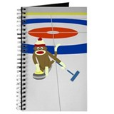 Curling sock monkey Journals & Spiral Notebooks
