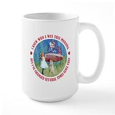 I KNEW WHO I WAS THIS MORNING Ceramic Mugs