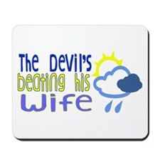 The Devil's Beating His Wife Mousepad