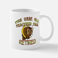 retired teacher with owl copy Mugs