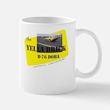 the YELLA BRICK in action Mug