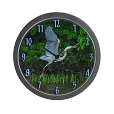Heron taking flight Wall Clock