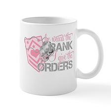 He Wears the Rank But I give Mug