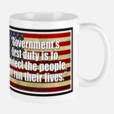 REAGAN: Government's first duty... QUOTE Mug