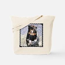 Sun Bear Holding Foot Tote Bag