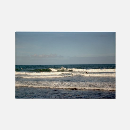 Surfers at Honoli'i Beach Rectangle Magnet