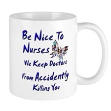 be nice to nurses butterfly copy Mugs
