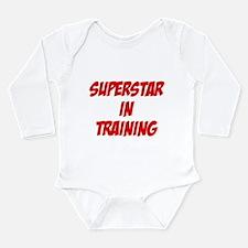 superstar in training Long Sleeve Infant Bodysuit