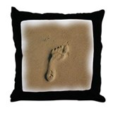 Footprints in the sand Throw Pillows