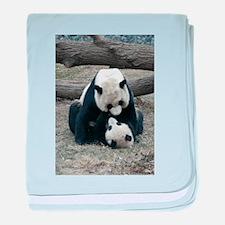 Mei hugs Tai baby blanket