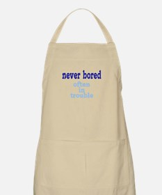 Never Bored, Often In Trouble Apron