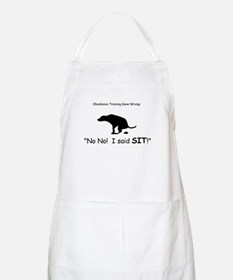 I said sit! Apron
