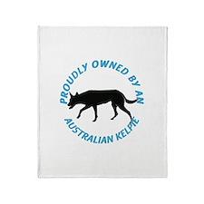 Proudly Owned Kelpie Throw Blanket