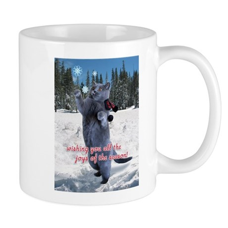 Cat catching snowflakes card Mug