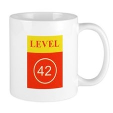 L42 vertical logo Mugs