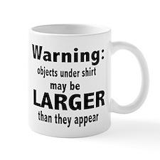 Warning objects under shirt m Mug