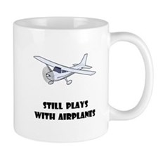 Still Plays With Airplanes Mug