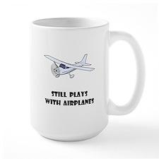 Still Plays With Airplanes Mug