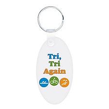 tri, tri again Keychains