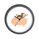 Baby monkey riding on a pig Wall Clocks
