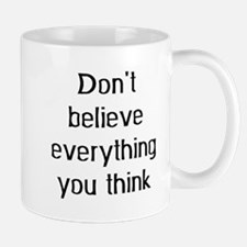 don't believe everything Small Mug