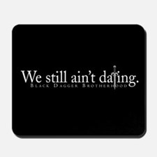 """We still ain't dating"" Black Mousepad"