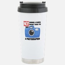 Cute Owning a camera doesn%27t make you a photographer Travel Mug