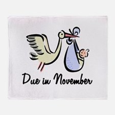 Due In November Stork Throw Blanket