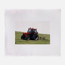 A Red Tractor On The Go Throw Blanket