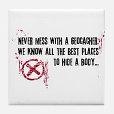 Geocaching - never mess dark red Tile Coaster
