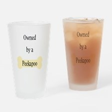 Owned by a Peekapoo Drinking Glass
