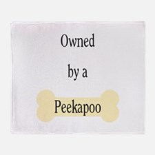 Owned by a Peekapoo Throw Blanket