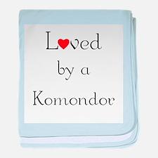 Loved by a Komondor baby blanket
