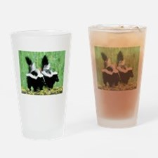 Two Skunks Drinking Glass