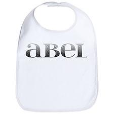 Abel Carved Metal Bib
