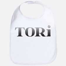 Tori Carved Metal Bib