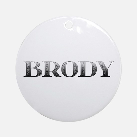 Brody Carved Metal Round Ornament