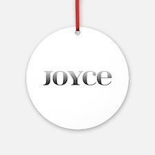 Joyce Carved Metal Round Ornament