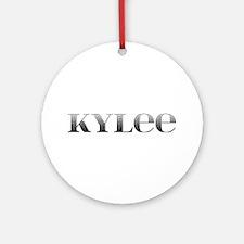 Kylee Carved Metal Round Ornament