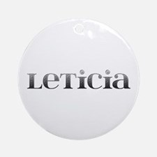 Leticia Carved Metal Round Ornament