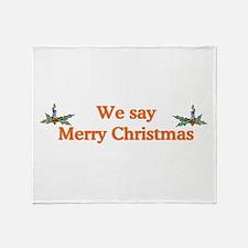 We say Merry Christmas Throw Blanket