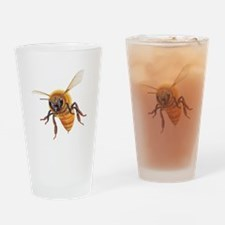 Bee in flight Drinking Glass