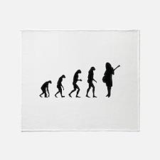 Evolution guitar player Throw Blanket