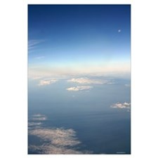 Aerial clouds with full moon and earth below