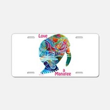 Manatees of Many Colors Aluminum License Plate