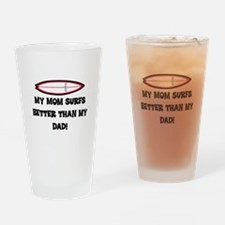 MOM SURFS BETTER THAN DAD (ORIG) Drinking Glass