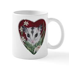 marcell heart cutout Mugs